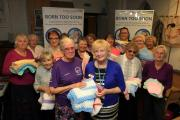 Stitch up: 'Granny Mo' surprises Kingston Hospital baby charity with stack of knitted gifts